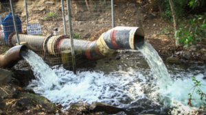 Pipe dumping water into river